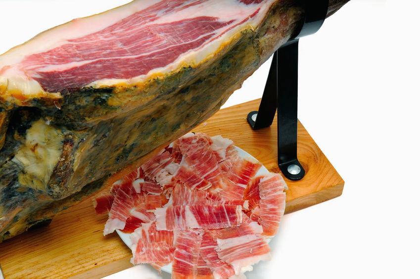 50326069 - iberian ham with a plate of slices of ham. typical spanish
